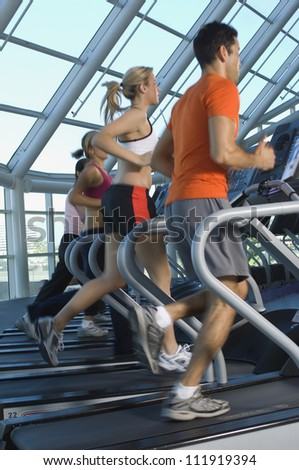 People exercising on treadmill - stock photo