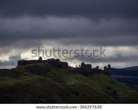 People exploring the ruins of Castell Dinas Bran late in the day, Llangollen, Wales.
