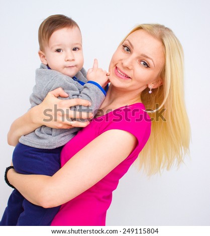people, family, motherhood and children concept - happy mother hugging adorable baby - stock photo