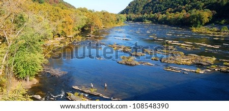 People fishing at Potomac River in Harpers Ferry, West Virginia - stock photo