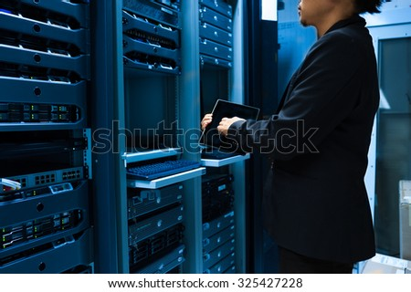 People fix server network in data room .