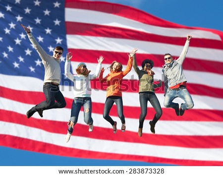 people, freedom, happiness and teenage concept - group of happy international friends in sunglasses jumping high over american flag background - stock photo