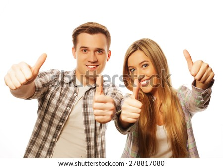 people, friendship, love and leisure concept - lovely couple with thumbs-up gesture isolated on white - stock photo