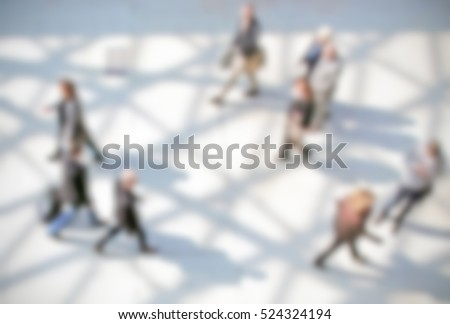 People generic background with an intentional blur effect applied. Humans and location not recognizable.
