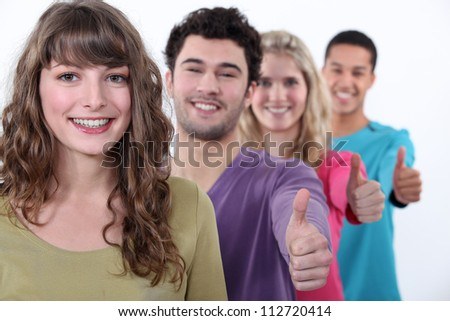 People giving the thumbs-up - stock photo