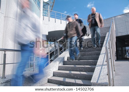 People go down on concrete ladder - stock photo