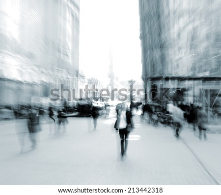 People going along the street. Intentional motion blur - stock photo