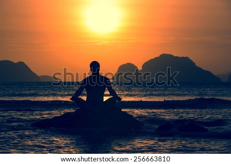 people greeted the dawn on the beach - stock photo