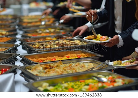 people group catering buffet food indoor in luxury restaurant with meat colorful fruits  and vegetables - stock photo