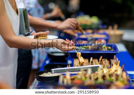 people group in the line catering buffet food indoor in luxury restaurant with meat colorful rice and vegetables - stock photo