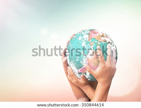 People hands holding planet. Cancer, Unity, CSR, Press, Kids, Trust, Help, Service, Join, Now, Many, Collage, Event, Healthcare, Contact Us, Solidarity. Elements of this image furnished by NASA - stock photo