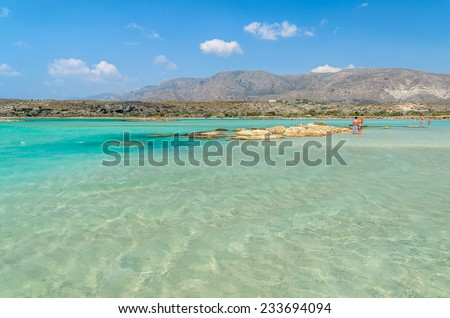 People have a joy at Elafonisi beach. Elafonisi beach is one of the most popular beaches on Crete island - stock photo