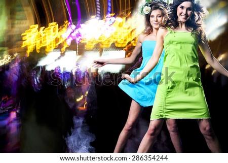 People have fun at night. - stock photo