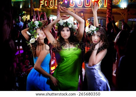People have fun at night on a beach. - stock photo