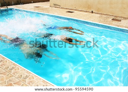People having fun in  swimming pool.