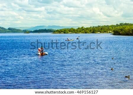 People having fun on a sunny day at the Luss Pier, Loch Lomond, Argylle and bute, Scotland, 21 July, 2016