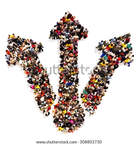 People headed into different directions . Large groups of people in the shape of arrows taking different routes. - stock photo