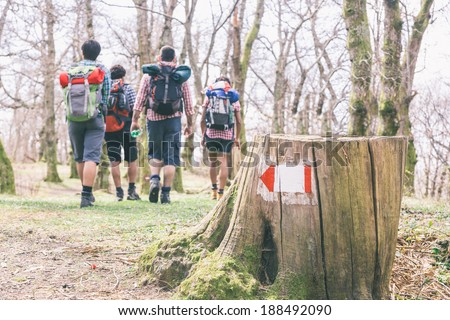 People Hiking at Top of Mountain - stock photo