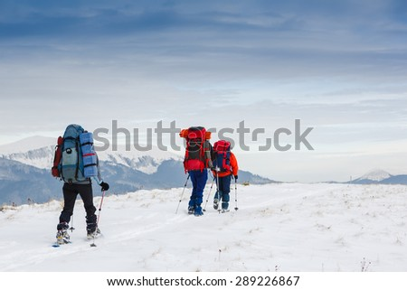 people hiking in beautiful mountain nature landscape