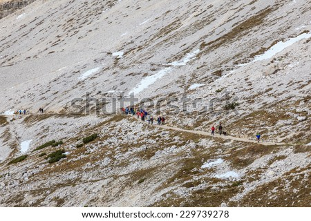 People hiking in Drei Zinnen Nature Park in Italy dolomites