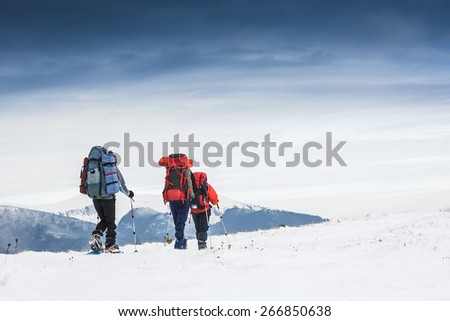 people hiking in winter mountains - healthy active lifestyle - stock photo