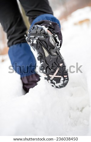 People hiking walking in white winter forest on deep snow. Recreation and healthy lifestyle outdoors in nature, motivational and healthy concept, trekking boots. - stock photo