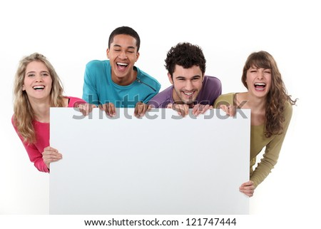 People holding a message board - stock photo