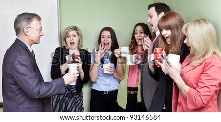 People holding ceramic coffee cups looking in horror at mans eco unfriendly Styrofoam cup - stock photo
