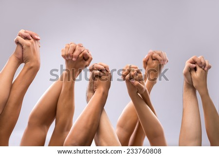 People holding hands of each other: unity concept - stock photo
