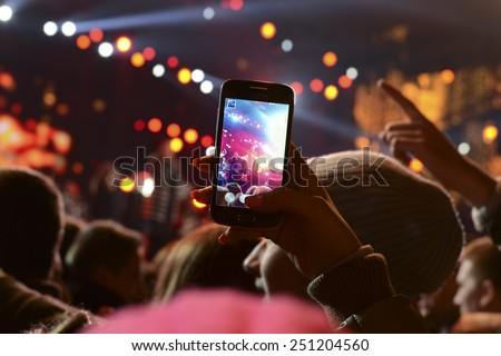 People holding their smart phones and photographing concert - stock photo