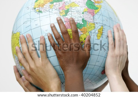 People holding up a globe - stock photo
