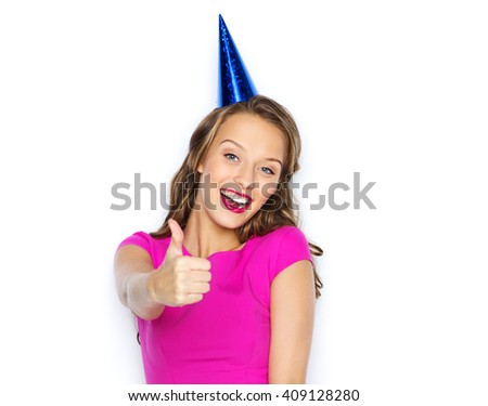 people, holidays and celebration concept - happy young woman or teen girl in pink dress and party cap - stock photo