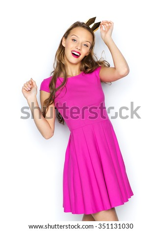 people, holidays and fashion concept - happy young woman or teen girl in pink dress and princess crown - stock photo