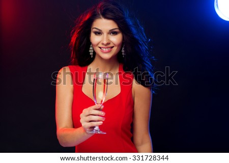 people, holidays, party, night lifestyle and leisure concept - beautiful sexy woman in red dress with champagne glass at night club - stock photo