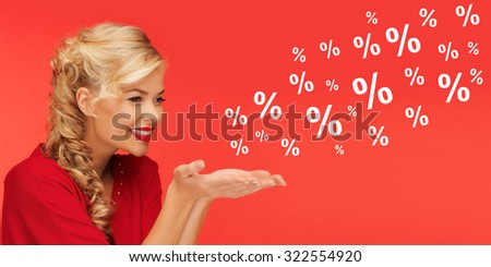 people, holidays, sale, shopping and advertisement concept - lovely woman in red clothes holding something on palms of her hands over red background with percentage signs - stock photo