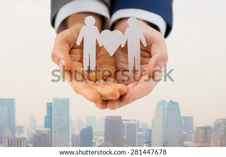 people, homosexuality, same-sex marriage and love concept - close up of male gay couple holding love and gender symbol - stock photo