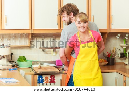People, housework and housekeeping concept. Couple doing the washing up together in kitchen interior - stock photo