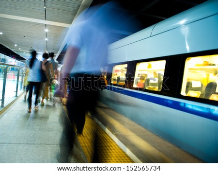 People hurrying to catch a train. blurred motion