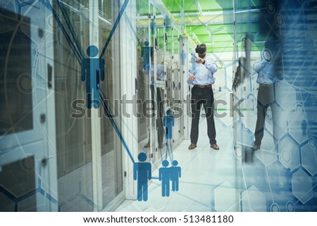 People icons and binary codes against technician standing in server room while using virtual reality headset
