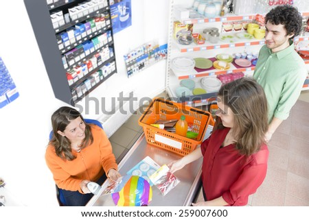 People in a market at checkout - stock photo