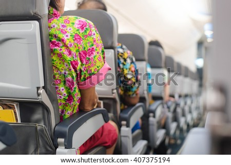 people in aircraft cabin ,business travel. - stock photo