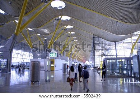 People in airport, madrid, spain - stock photo