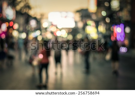 People in bokeh, Crowd of people in Bang La Road during night life, Phuket, Thailand - stock photo