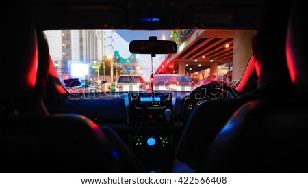 people in car  at Traffic intersection - stock photo