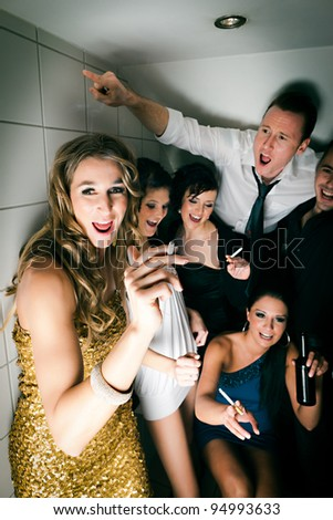 People in club and smoking a cigarette in the toilet and have lots of fun - stock photo