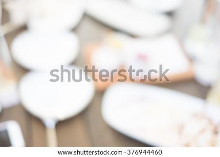people in coffee shop as blur background