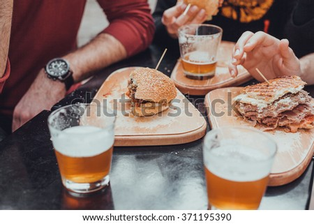 People In Fast Food Restaurant Having Lunch - stock photo