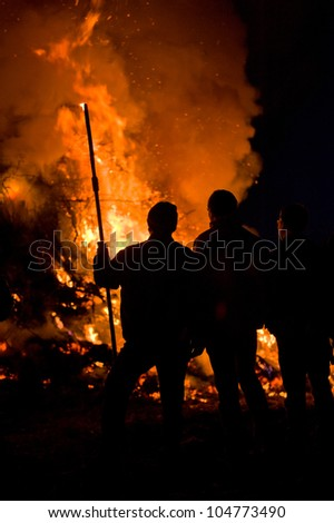 people in front of big fire