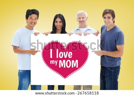 People in jeans holding and showing a big sign against yellow vignette - stock photo