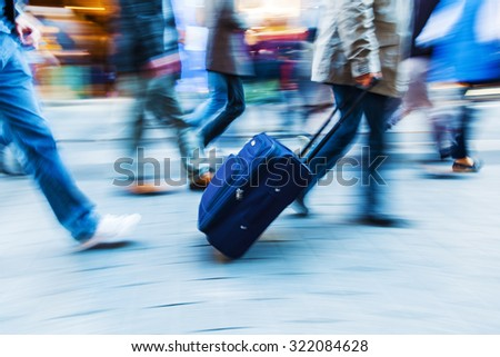people in motion blur on the move in the city - stock photo